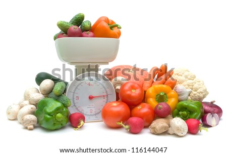Fresh ripe vegetables and kitchen scales isolated on white background - stock photo
