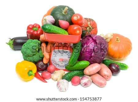 Fresh ripe vegetables and kitchen scales isolated on white background. horizontal photo - view from the top. - stock photo