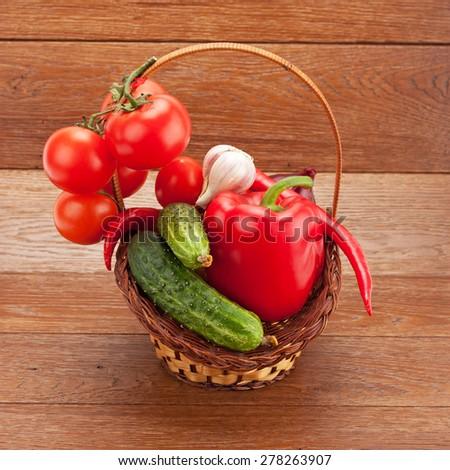 fresh ripe vegetables arranged in a wicker basket - stock photo