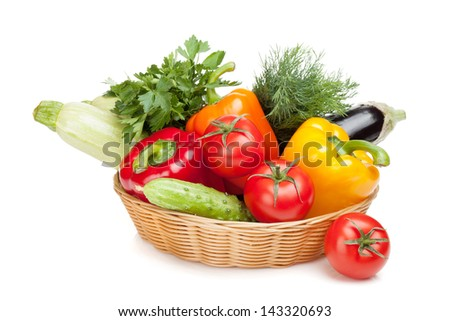 Fresh ripe vegetables in basket. Isolated on white background - stock photo