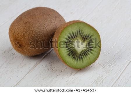 Fresh ripe vivid Kiwi fruit sliced - stock photo