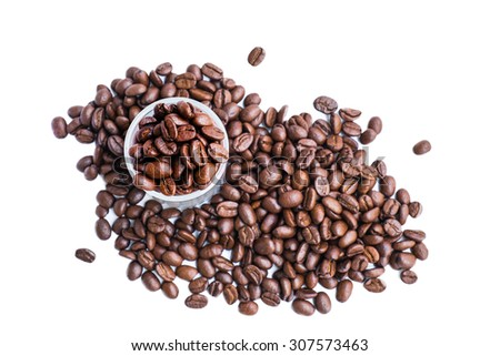 Fresh roasted coffee beans in coffee shot glass - stock photo