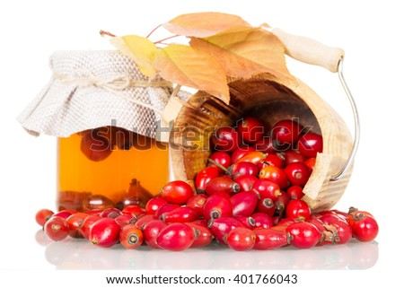 Fresh rosehip berries and soda cans isolated on white background. - stock photo