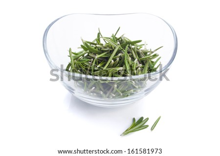 Fresh rosemary leaves in a glass bowl on white background - stock photo
