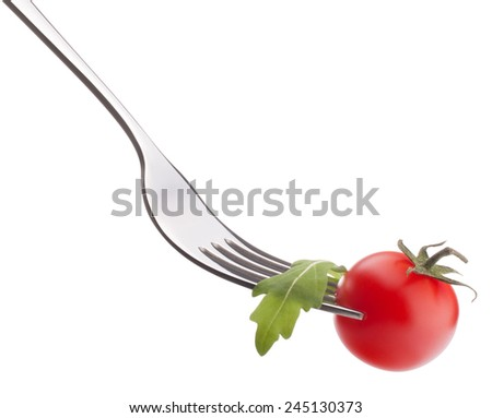 Fresh rucola  salad and cherry tomato on fork isolated on white background cutout. Healthy eating concept. - stock photo