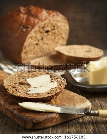 Fresh rye bread and butter - stock photo