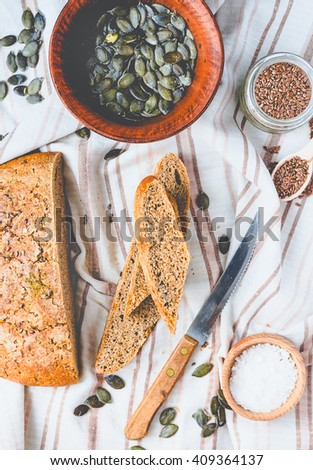 fresh rye bread with flax seeds and pumpkin, yeast free, crisp, clean eating - stock photo