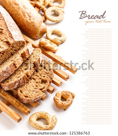 Fresh rye sliced bread on kichen board over white - stock photo