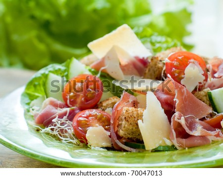 Fresh salad from vegetables, cheese and ham - stock photo