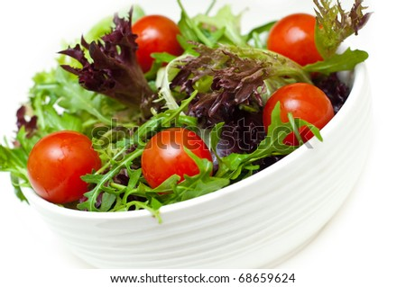 fresh salad in a bowl on a white background - stock photo