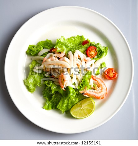 fresh salad leaves with lime and shrimp - stock photo