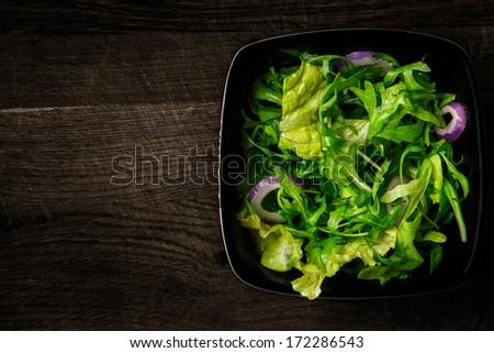 Fresh salad on the wood - stock photo