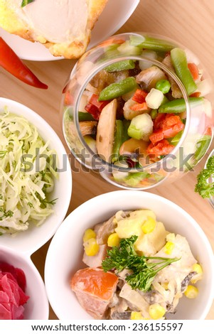 fresh salad  on wooden plate - stock photo