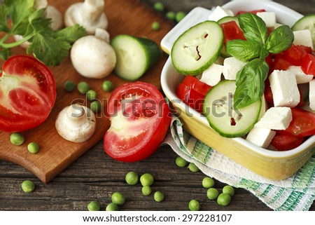 fresh salad tomato cucumber with cheese - stock photo
