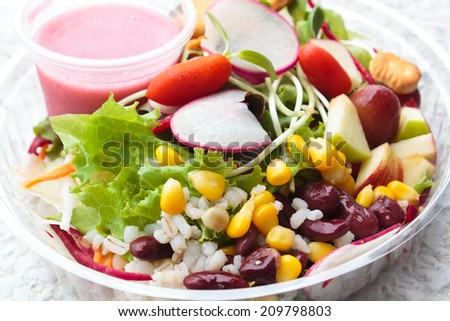 fresh salad vegetable and fruit with sauce mixberry. - stock photo
