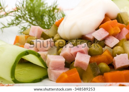 Fresh salad with assorted greens, fried pork, carrots, croutons, parmesan cheese, and mushrooms - stock photo