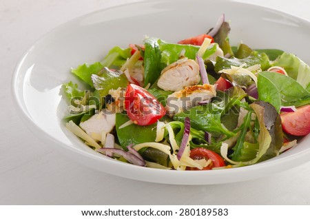 Fresh Salad with chicken on  white plate. Selective focus - stock photo