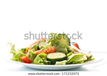 fresh salad with cucumbers and tomatoes on a white background - stock photo