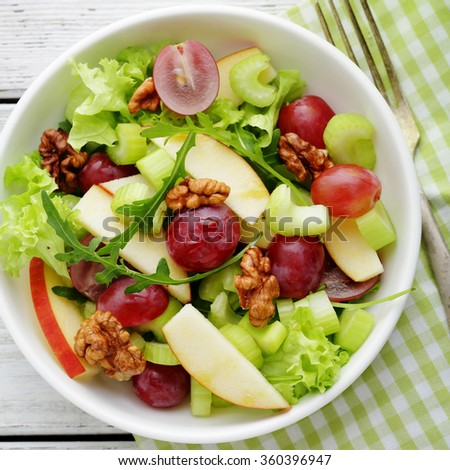fresh salad with green apple and celery, food closeup - stock photo