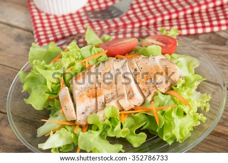 Fresh salad with grilled chicken breast, lettuce and tomato. - stock photo