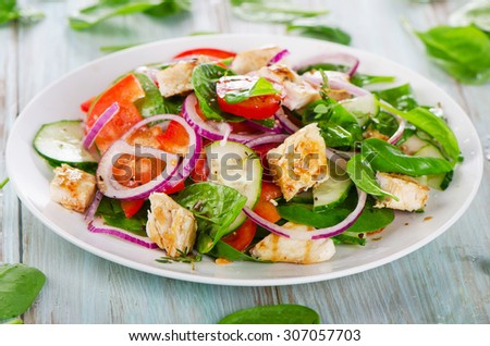 Fresh salad with grilled chicken breast. Selective focus - stock photo
