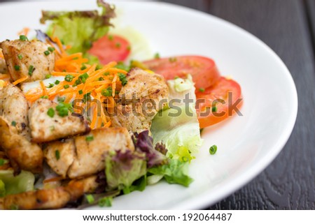 Fresh salad with grilled meet and yogurth dressing - stock photo