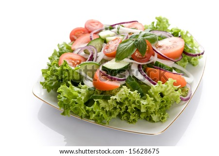 Fresh salad with onion, tomato and basil - stock photo