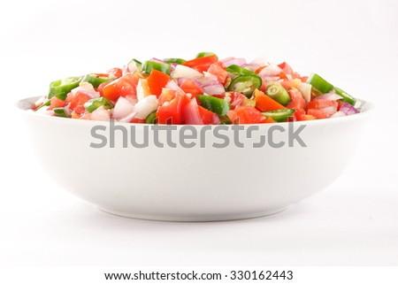 Fresh salad with onions ans tomato. - stock photo