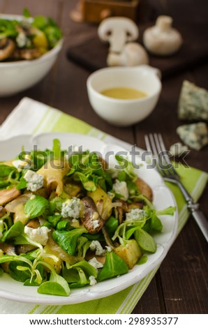 Fresh salad with roasted potatoes, mushrooms and lamb lettuce salad with mustard dip and blue cheese - stock photo