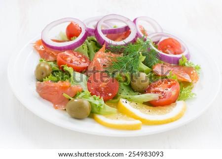 fresh salad with salted salmon, close-up, horizontal - stock photo