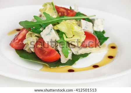 Fresh salad with spinach, cherry tomatoes, blue cheese and arugula. Close up image. - stock photo