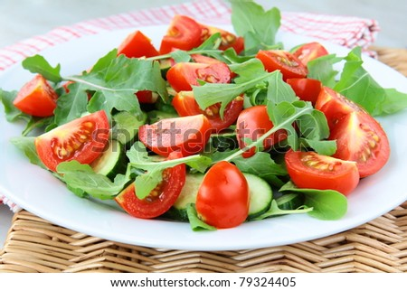 fresh salad with tomatoes cherry, arugula and basil - stock photo
