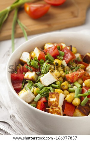 fresh salad with tomatoes garlic and chickpea - stock photo