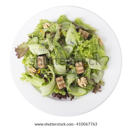Fresh salad with walnuts and grilled tofu cheese. Isolated on a white background. - stock photo