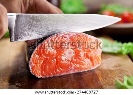 Fresh salmon. Cooking process. - stock photo