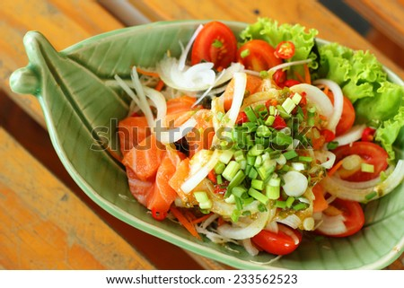 Fresh salmon salad with spices - Japanese food. - stock photo