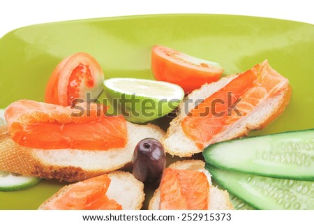 fresh salmon sandwiches and vegetables isolated on white - stock photo