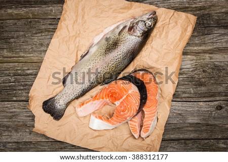 Fresh salmon slice on old wood - stock photo