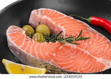 Fresh salmon steak on pan. Whole background. - stock photo