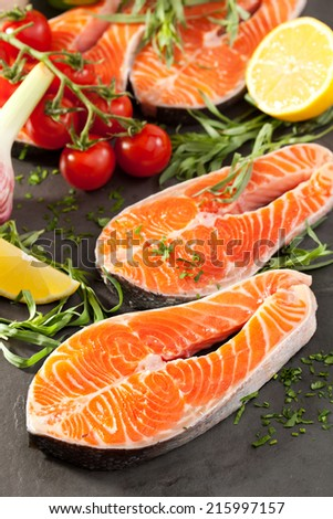 Fresh Salmon Steak with Lemon Slice - stock photo