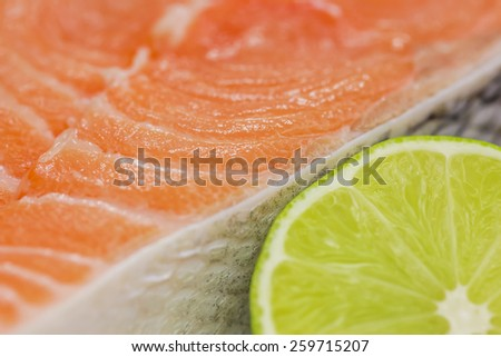 Fresh salmon steak with lime close up - stock photo