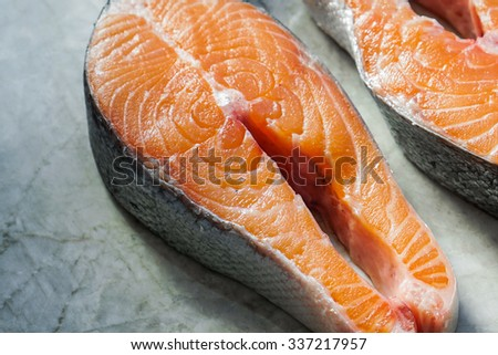 Fresh salmon steaks on marble background/ Selective Focus/ Close up - stock photo