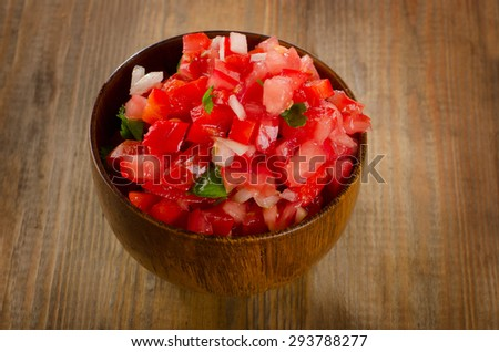 Fresh salsa dip on  a wooden table. Selective focus - stock photo