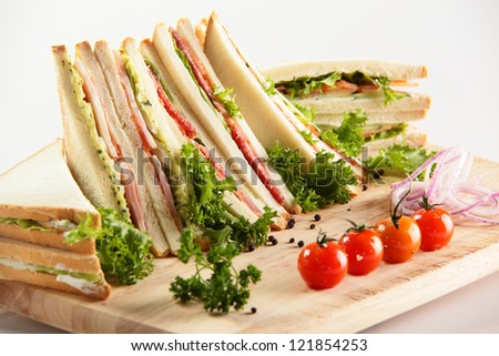 fresh sandwiches on wooden desk and white background - stock photo