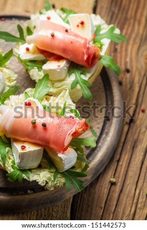 Fresh sandwiches with parma ham, brie cheese and rocket salad - stock photo