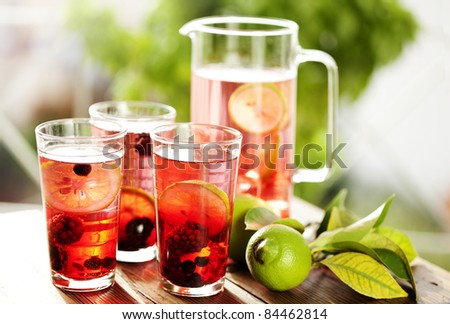 fresh sangria made with pieces of fruit inside and fresh lime - stock photo