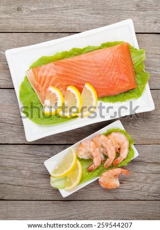 Fresh sea food on wooden table - stock photo