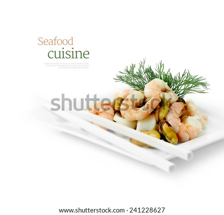 Fresh seafood cuisine against white. Copy space. - stock photo