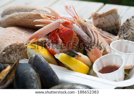 Fresh seafood platter served with lemon and bread - stock photo