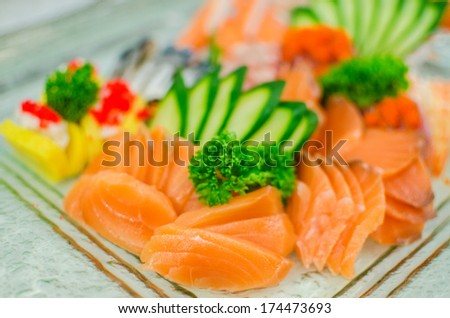 Fresh seafood sashimi and sushi in restaurant - stock photo